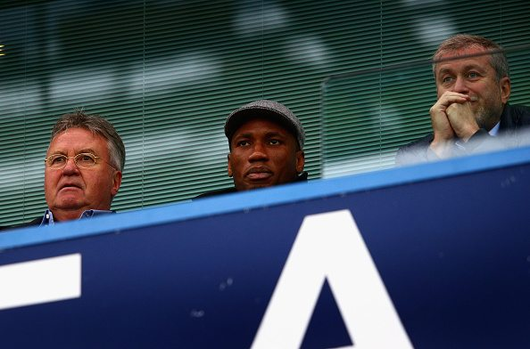 LONDON, ENGLAND - DECEMBER 19: Chelsea interim manager Guus Hiddink (L), Didier Drogba (C) of Montreal Impact and Chelsea owner Roman Abramovich (R) are seen on the stand prior to the Barclays Premier League match between Chelsea and Sunderland at Stamford Bridge on December 19, 2015 in London, England. (Photo by Clive Mason/Getty Images)