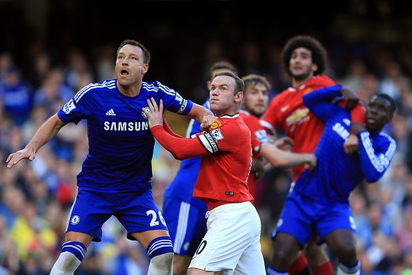 LONDON, ENGLAND - April 18: John Terry of Chelsea tangles with Wayne Rooney of Manchester United during the Barclays Premier League match between Chelsea and Manchester United at Stamford Bridge on April 18, 2015 in London, England. (Photo by Marc Atkins/Mark Leech/Getty Images)