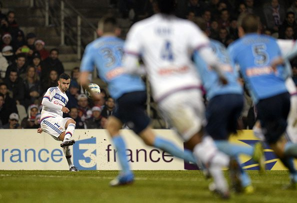 Lyon's Algerian midfielder Rachid Ghezzal shoots the ball during the French League Cup football round of sixteen match between Olympique Lyonnais (OL) and Tours (FCT) at the Gerland stadium in Lyon, central eastern France, on December 16, 2015. / AFP / ROMAIN LAFABREGUE (Photo credit should read ROMAIN LAFABREGUE/AFP/Getty Images)