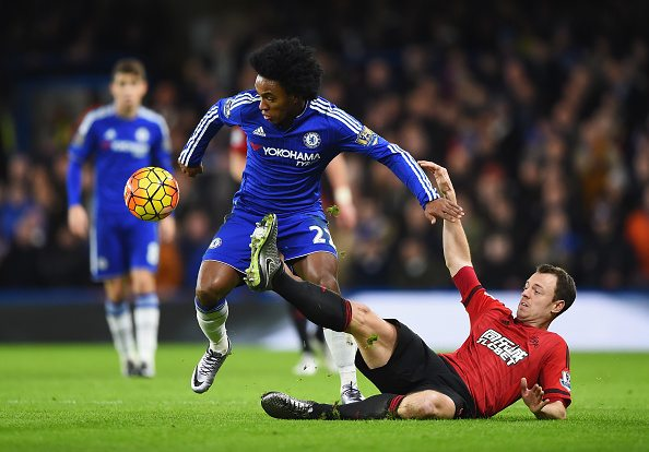 LONDON, ENGLAND - JANUARY 13: Willian of Chelsea and Jonny Evans of West Bromwich Albion compete for the ball during the Barclays Premier League match between Chelsea and West Bromwich Albion at Stamford Bridge on January 13, 2016 in London, England. (Photo by Shaun Botterill/Getty Images)