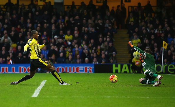 WATFORD, ENGLAND - DECEMBER 28: Odion Ighalo (L) of Watford scores his team's first goal past Hugo Lloris (R) of Tottenham Hotspur during the Barclays Premier League match between Watford and Tottenham Hotspur at Vicarage Road on December 28, 2015 in Watford, England. (Photo by Richard Heathcote/Getty Images)