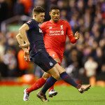 LIVERPOOL, ENGLAND - JANUARY 30:  Aaron Cresswell of West Ham United is watched by Jordon Ibe of Liverpooll during the Emirates FA Cup Fourth Round match between Liverpool and West Ham United at Anfield on January 30, 2016 in Liverpool, England.  (Photo by Clive Brunskill/Getty Images)