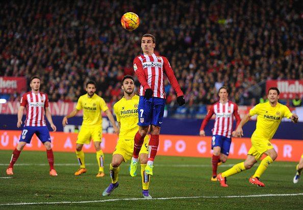 MADRID, SPAIN – FEBRUARY 21: Antoine Greizmann of Club Atletico de Madrid  heads the ball beside Victor Ruiz of Villarreal CF during the La Liga match  ...