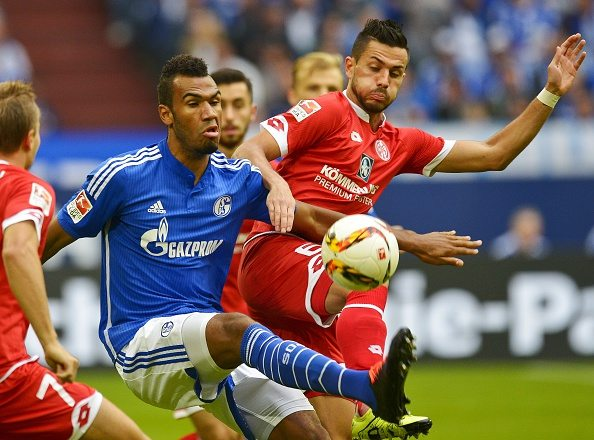 Schalke's Cameroonian forward Eric Maxim Choupo-Moting (L) and Mainz' midfielder Danny Latza vie for the ball during the German first division Bundesliga football match FC Schalke 04 v 1 FSV Mainz 05, in Gelsenkirchen, on September 13, 2015. AFP PHOTO / SASCHA SCHUERMANN RESTRICTIONS: DURING MATCH TIME: DFL RULES TO LIMIT THE ONLINE USAGE TO 15 PICTURES PER MATCH AND FORBID IMAGE SEQUENCES TO SIMULATE VIDEO. == RESTRICTED TO EDITORIAL USE == FOR FURTHER QUERIES PLEASE CONTACT DFL DIRECTLY AT + 49 69 650050. (Photo credit should read SASCHA SCHUERMANN/AFP/Getty Images)