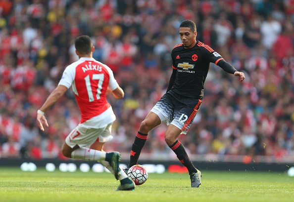 LONDON, ENGLAND - OCTOBER 04: Chris Smalling of Manchester United during the Barclays Premier League match between Arsenal and Manchester United at the Emirates Stadium on October 04, 2015 in London, United Kingdom. (Photo by Catherine Ivill - AMA/Getty Images)