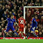 LIVERPOOL, ENGLAND - DECEMBER 26:  Christian Benteke of Liverpool (L) scores his side's first goal past Kasper Schmeichel of Leicester City (r) during the Barclays Premier League match between Liverpool and Leicester City at Anfield on December 26, 2015 in Liverpool, England.  (Photo by Chris Brunskill/Getty Images)
