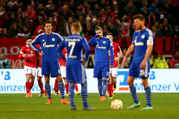 MAINZ, GERMANY - FEBRUARY 12: Roman Neustaedter of FC Schalke 04 and his team-mates react after conceding a second goal during the Bundesliga match between 1. FSV Mainz 05 and FC Schalke 04 at Coface Arena on February 12, 2016 in Mainz, Germany. (Photo by Alex Grimm/Bongarts/Getty Images)