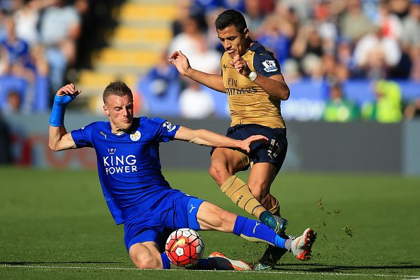 LEICESTER, ENGLAND - SEPTEMBER 26: Jamie Vardy of Leicester City in action with Alexis Sanchez of Arsenal during the Barclays Premier League match between Leicester City and Arsenal at the King Power Stadium on September 26, 2015 in Leicester, United Kingdom. (Photo by Marc Atkins/Mark Leech/Getty Images)