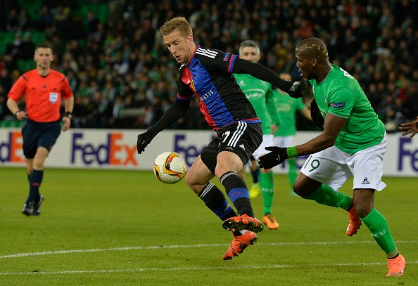 Basel's Austrian forward Marc Janko (L) vies for the ball with Saint-Etienne's Guinean defender Florentin Pogba (R) during the UEFA Europa league round of sixteen football match Saint-Etienne (ASSE) vs Basel (FCB) on February 18, 2016, at the Geoffroy Guichard Stadium in Saint-Etienne, central France. AFP PHOTO / JEAN-PHILIPPE KSIAZEK / AFP / JEAN-PHILIPPE KSIAZEK (Photo credit should read JEAN-PHILIPPE KSIAZEK/AFP/Getty Images)