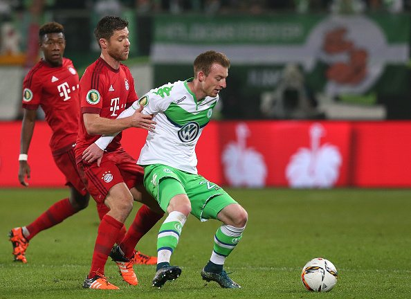 WOLFSBURG, GERMANY - OCTOBER 27: Maximilian Arnold (R) of Wolfsburg vies with Xabi Alonso (L) of Muenchen during the DFB Cup second round match between VfL Wolfsburg and FC Bayern Muenchen at Volkswagen Arena on October 27, 2015 in Wolfsburg, Germany. (Photo by Ronny Hartmann/Bongarts/Getty Images) *** Local caption *** Maximilian Arnold; Xabi Alonso