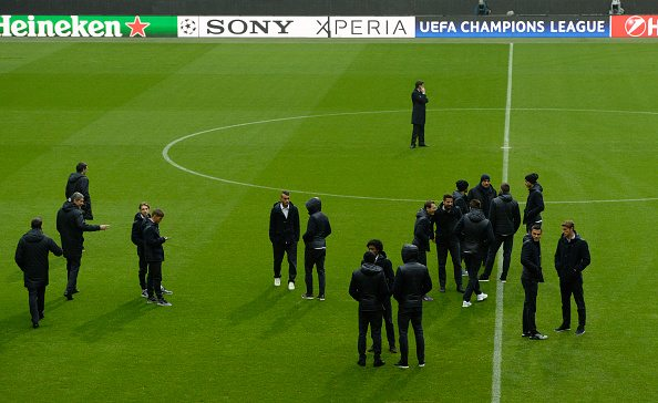 Several Juventus players stand at the field during a visit to the Bayern Munich stadium, one day before the Champions League last 16, second-leg match between Bayern Munich and Juventus Turin in the stadium in Munich, southern Germany, on March 15, 2016. / AFP / CHRISTOF STACHE (Photo credit should read CHRISTOF STACHE/AFP/Getty Images)
