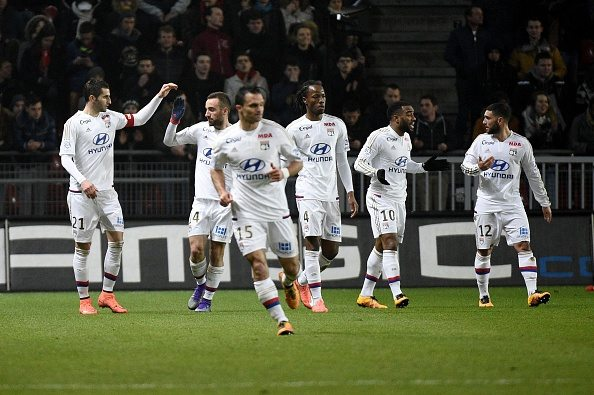 Lyon's players celebrates after scoring a goal during the French L1 football match Rennes against Lyon on March 13, 2016 at the Roazhon park stadium in Rennes, western France. AFP PHOTO / DAMIEN MEYER / AFP / DAMIEN MEYER (Photo credit should read DAMIEN MEYER/AFP/Getty Images)