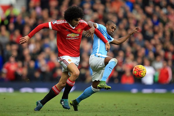MANCHESTER, ENGLAND - OCTOBER 25: Fernandinho of Manchester City tangles with Marouane Fellaini of Manchester United during the Barclays Premier League match between Manchester United and Manchester City at Old Trafford on October 25, 2015 in Manchester, England. (Photo by Marc Atkins/Mark Leech/Getty Images)