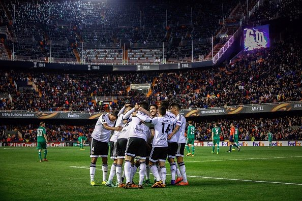Valencia's players celebrate a goal during the UEFA Europa League Round of 32 first leg football match Valencia CF vs SK Rapid Wien at the Mestalla stadium in Valencia on February 18, 2016. / AFP / BIEL ALINO (Photo credit should read BIEL ALINO/AFP/Getty Images)
