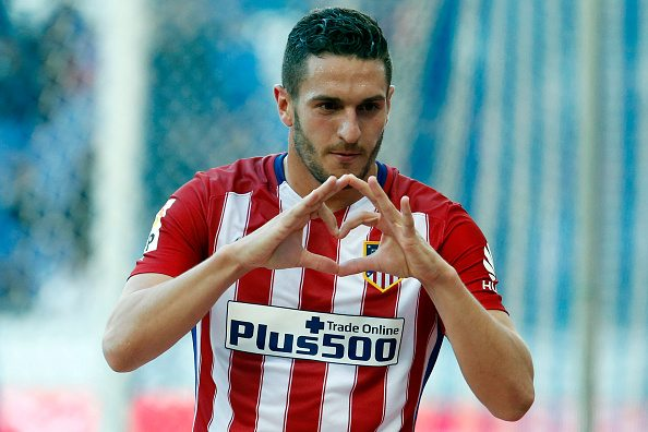 Atletico Madrid's midfielder Koke gestures as he celebrates a goal during the Spanish league football match RCD Espanyol vs Club Atletico de Madrid at the Cornella-El Prat stadium in Cornella de Llobregat on April 9, 2016. / AFP / PAU BARRENA (Photo credit should read PAU BARRENA/AFP/Getty Images)
