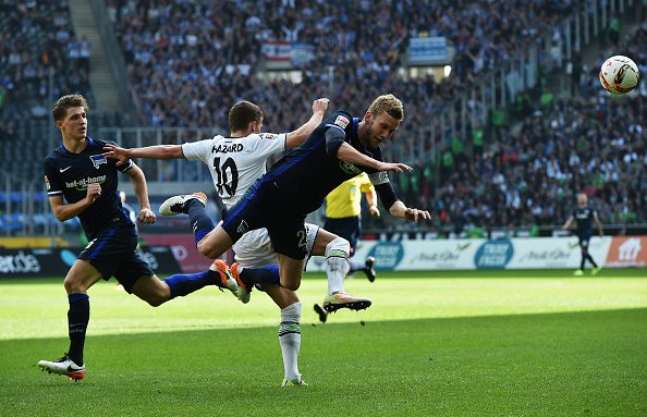 MOENCHENGLADBACH, GERMANY - APRIL 03: of Gladbach is challenged by of Berlin during the Bundesliga match between Borussia Moenchengladbach and Hertha BSC at Borussia-Park on April 3, 2016 in Moenchengladbach, Germany. (Photo by Stuart Franklin/Bongarts/Getty Images)