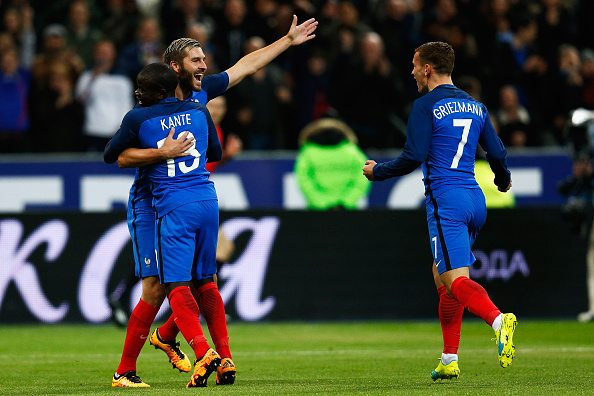 PARIS, FRANCE - MARCH 29: N'Golo Kante of France celebrates scoring his teams first goal of the game with teammates Andre-Pierre Gignac and Antoine Griezmann during the International Friendly match between France and Russia held at Stade de France on March 29, 2016 in Paris, France. (Photo by Dean Mouhtaropoulos/Getty Images)
