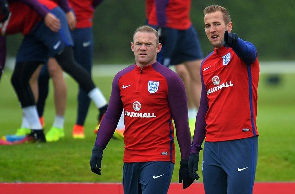 England's striker Harry Kane (R) gestures as he talks with England's striker Wayne Rooney during a team training session in Watford, north of London, on June 1, 2016. England are set to play Portugal in an international friendly football match at Wembley on June 2, ahead of Euro 2016. / AFP / GLYN KIRK / NOT FOR MARKETING OR ADVERTISING USE / RESTRICTED TO EDITORIAL USE (Photo credit should read GLYN KIRK/AFP/Getty Images)