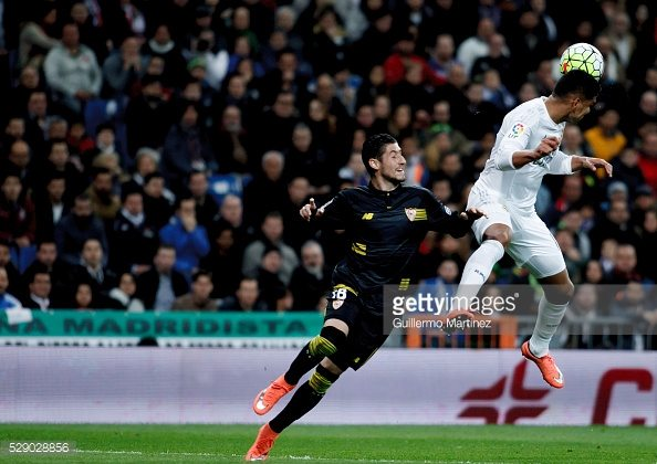 SPAIN, Madrid:Real Madrid's Brazilian midfielder Carlos Casemiro and Sevilla FC´s Spanish defender player Sergio Escudero during the Spanish League 2015/16 match between Real Madrid and Sevilla, at Santiago Bernabeu Stadium in Madrid on March 20, 2016. (Photo by Guillermo Martinez)