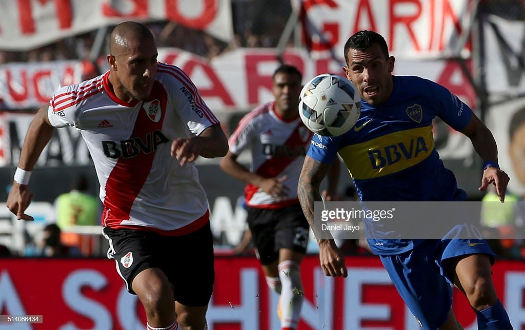 Carlos Tevez, of Boca Juniors,(R) and Jonatan Maidana, of River Plate